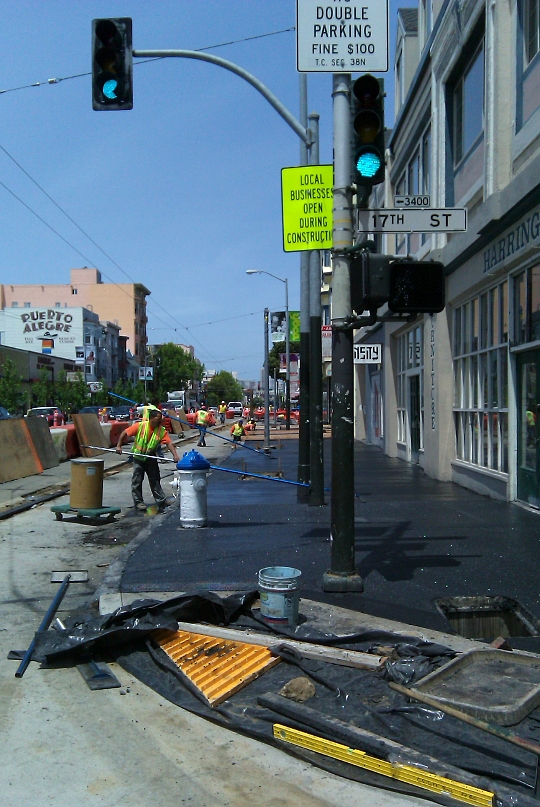 Valencia East Sidewalks Getting Laid, San Francisco