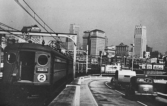 Southern Pacific electric train across the Bay Bridge, San Francisco; photo by Seymour Snaer